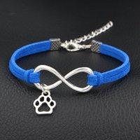 pulseira de couro do cão venda por atacado-Infinito amor do vintage Pet Cat Dog Pata Pulseira Pingente para Mulheres Homens Elegante Azul Escuro Camurça Corda de Couro Presente do Partido Moda Jóias Traje
