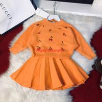 conjuntos de falda suéter de las niñas al por mayor-Conjunto de falda de niña de otoño blusa de ropa de diseñador para niños + falda 2 piezas conjunto de jersey de suéter de cachemira tamaño 100-140 nuevo