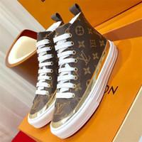 zapatos con cordones para mujer al por mayor-Womens Stellar Sneaker Boots Ladies Luxury Designer Shoes Lace Up Pisos Sneakers High top Plataforma Botines Moda Cuero Casual ShoesLLL23
