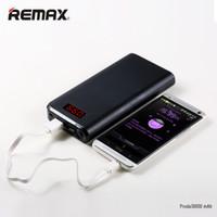 remax power bank charger venda por atacado-REMAX Dual USB LED Portátil de Luz 10000-30000 Mah Powerbank Banco de Potência de Alta Capacidade Externo Telemóveis PC Carregador de Bateria