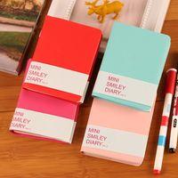 ingrosso vendita di libri di tasca-Vendita calda Cute Colorful Mini Smile Notebook in pelle 8 * 10.5CM taccuini tascabili per studenti Diario di moda per il libro d'affari