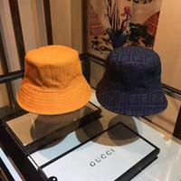 головные уборы для мужчин оптовых-Люксовый модный бренд Bucket шляпы буквы Цветная полоска Двухсторонняя шляпа рыбака высокого качества классический черный белый мужчины и женщины путешествия шляпа от солнца