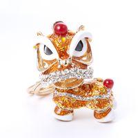bolsas de regalo de león al por mayor-Hys05 Chino Tradicional Colorido Interesante Fancy Lion Llavero de la Danza de China Town Feliz Año Nuevo Regalo Bolsa de Fiesta Bolso Encanto Llavero Anillo