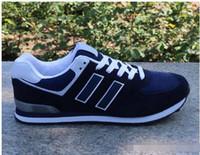 zapatillas de malla de corte bajo al por mayor-Moda zapatillas de deporte de lujo Mocasines Diseñadores Hombres Mujeres Low Cut Zapato deportivo informal Zapatillas Run Unisex 574 Malla Zapato ligero para caminar