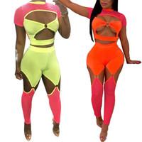 clubwear pants sets großhandel-Fluoreszenzfarbe Frauen Sexy Zweiteiler Fischnetz Patchwork Aushöhlen Kurzarm Crop Top + Dünne Hosen Clubwear