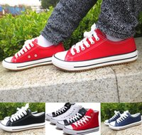 precio de zapatos de lona blanca al por mayor-Precio de fábrica ¡precio promocional! Femininas zapatos de lona para mujeres y hombres, zapatillas de lona clásicas de estilo alto / bajo, zapatillas de lona blancas