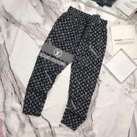 материалы для наружной печати оптовых-Париж мода мужские брюки бренд повседневные брюки топ материал свободные галстук письмо печать шить нить ноги открытый торговый партии одежда