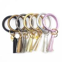 bracelets enroulés jaune achat en gros de-Tassel Charms En Cuir Wrap Bracelets Pendentif Chaîne Bracelets Clés Anneaux Bracelets De Mode Avec Blanc Noir Jaune Couleur 8 5by J1