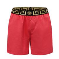 shorts de homem relaxado venda por atacado-Novo Luxo Mens Calças Calções de Praia Verão Preto e Branco Carta Impressão Relaxado Homme Sweatpants 002 #
