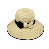 sombrero de paja para mujer de moda al por mayor-Maxi Gorra de trenza de hierba de alta calidad Sombrero de paja para mujer Disquete de ala ancha Contraste de color simple Arco de moda Accesorios de playa Packable