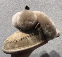 ingrosso pantofole a casa mocassini-Brand Design Donne in pelle di mucca Pantofole Mocassini Moda Snow Boots invernali in Australia pelliccia di Bowknot palla di pelle di pecora piatto Pantofole, 35-40