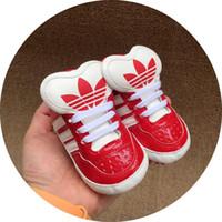 zapatos publicitarios al por mayor-Zapatillas de deporte deportivas más nuevas de AD Canvas 5 colores Newborn Boys Girls First Walkers Infantil Toddler Soft suela Prewalker Sneakers para 0-18Mos