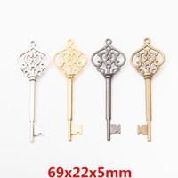 Wholesale gun heart pendant for sale - Group buy 20pcs MM Vintage silver gold gun black heart key charms antique bronze key pendants for bracelet earring diy jewelry making