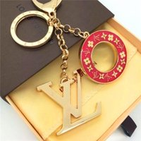 Wholesale fashion finder resale online - Delicate circular letter luxury key chain multiple pendant bag charm fashion key chain