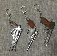anel pistola pistola venda por atacado-Revólver Chaveiros-Men Game Gun Modelo Coleção Pistol Chaveiro Anel Revólver Lembrança Men Boy Presente Mulheres Saco Charme