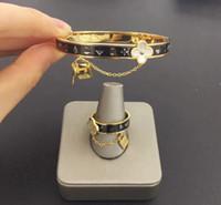 travamento de pulseiras venda por atacado-Europeu e Americano de moda nova marca L shell mulheres anel de aço 316L titanium bangle flor bloqueio designer atacado