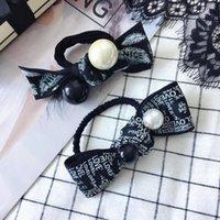 perle noire avec cheveux achat en gros de-20190706 Plumes de lettres, perles noires et blanches, noeuds attachés, anneaux pour cheveux