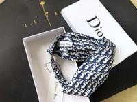 mädchen schal stil großhandel-Designer D Buchstaben Stil Stirnband für Männer und Frauen 2019 neue Frühling Kreuz elastische Mode Stirnbänder für Mädchen hochwertige Markenschals