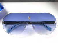 Wholesale sunglasses skull for sale - 0030 skull logo fashion Sunglasses Rimless connection lens trend avant garde glasses for mens womens anti UV eyewear with original box