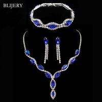 ingrosso collana di cerimonia nuziale del rhinestone blu reale-vendita all'ingrosso Elegante Royal Blue Crystal Set di gioielli da sposa Strass lungo nappa collana orecchini braccialetto set di gioielli da sposa