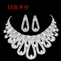 sistemas cristalinos del collar del diamante artificial de la joyería de la boda al por mayor-2019 Diseñador Perla Romántico Con Cristal Barato Dos Piezas Pendientes Collar Rhinestone Conjuntos de Novia de Boda Conjunto de Joyas Joyas