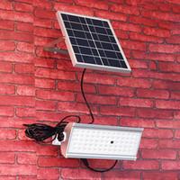led inalámbrico de control remoto controlado al por mayor-Venta al por mayor 65 Leds Solar Light Super Bright 1500lm 12W Spotlight Wireless Outdoor Waterproof Garden Solar Powered Lamp con control remoto