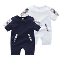 yürümeye başlayan çocuk bezi toptan satış-Bebek Lüks Tasarımcı Tulumlar Çanta Baskılı Yenidoğan Giysileri Toddlers Moda Tulum Çocuklar Kısa Kollu Bebek Tulum
