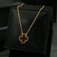 женские ожерелья оптовых-Мода дизайн с золотым краем цветы ожерелья женщин роскошный цветок кулон ожерелья высокое качество Золотой ювелирные изделия любовника подарок