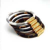 gestreiftes armband großhandel-Neue Art und Weisehippie-lederne gestreifte Armbandmänner und -frauen verbinden Armbandlegierungsmagnetschnallenarmbandgroßverkauf