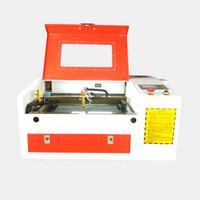 gravür makineleri fiyatları toptan satış-Taşınabilir mini lazer gravür 50 W makinesi lazer CO2 cam gravür masaüstü CNC 3040 lazer makinesi Fiyat ucuz elektrikli kaldırma tablosu ile