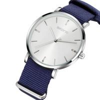 женщины skone watch оптовых-SKONE Fashion Casual Watch Men Women Quartz Clock Blue Nylon Straps Minimalist Dial Top Brand Luxury Wristwatches Lover Gift