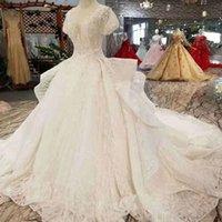 ingrosso grandi abiti da sposa in stile principessa-Principessa Abiti da sposa Pure Big V Neck Short Puffy Sleeves Wedding Gown 2019 Newest Design Ruffle Style Long Train Multi-Layer Bridal Gown