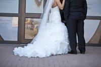 perla de perforación interna al por mayor-Crystal Pearls 2019 Nuevos vestidos de novia sin espalda Faldas escalonadas Granos Vestidos de novia de sirena Dror de Inbal Vestido de boda de lujo