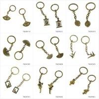 antike vogelkäfige großhandel-Metall Antique Bronze Keychain Schlüsselanhänger Keytag Schlüsselanhänger Ring Folding Fan Vogelkäfig Vogelkäfig Gabel Löffel Teller Swallow Rabbi