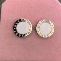 pendientes nuevos calientes al por mayor-2019 nuevo Top Deluxe marca Design hombres plata oro blanco negro cerámica Stud Earring Jewelry 3 colores para mujer moda de verano venta caliente