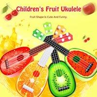 mini brinquedo de guitarra venda por atacado-Mini Instrumentos Musicais Cordas Guitarra Ukulele Bonito Crianças Fruta Guitarra Caixa de Presente Criativo Brinquedo da Primeira Infância Instrumento de Música crianças brinquedos