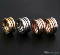 piedra de luna amarilla al por mayor-Nueva versión de acero titanium anillos de resorte hueco para mujeres hombres bulgaria boda anillo de compromiso joyería fina nunca se descolora