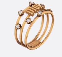 logo de promocion al por mayor-Promoción anillos de amantes de calidad superior bronce chapado en oro de 18 quilates con anillo hueco de diamante y logotipo anillos de boda conjuntos joyería envío de la gota PS5586