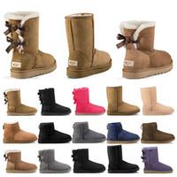schwarze kurze stiefel frauen großhandel-ugg boots 2020 neue Designer Stiefel Australien Frauen Mädchen klassische Schneeschuhe Bowtie Knöchel kurze Bogen Pelzstiefel für Winter schwarz Chestnut Mode Größe 36-41