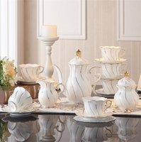 osso incrustado venda por atacado-Europa Ouro Inlay Osso China Conjunto De Café Porcelana Britânica Conjunto De Chá Cerâmica Pote Creamer Sugar Bowl Partido Bule de Café Xícara De Chá caneca