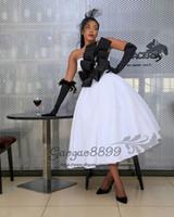 schwarzes korsett abendkleid großhandel-2019 Sexy schwarz-weiß Ballkleid Tee Länge Prom Kleider moderne trägerlose kurze formale Abend Party Kleider Korsett plus Größe