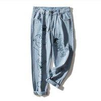 fábrica de moda jeans al por mayor-Ajuste al por mayor de 90 kg más el tamaño de los pantalones vaqueros marca de moda femenina patrón de dibujos animados impreso 100% algodón era pantalones vaqueros delgados wq1773 fábrica