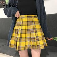 ingrosso gonne nere calde-2018 nuove donne Inghilterra stile casual nero giallo plaid a pieghe gonne pantaloncini vendita calda a vita alta plaid mini gonna plus size Y19061101