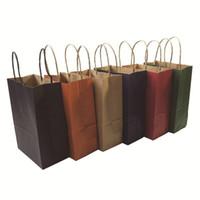 ingrosso negozio laser-40pcs sacchetto del regalo di carta kraft alla moda con maniglia / shopping bags / Natale marrone sacchetto di imballaggio / eccellente qualità 21x15x8 cm T8190629