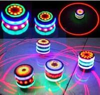 brinquedos de bebê cor música venda por atacado-Flash giroscópio luz Imitação de madeira giroscópio Flash rotativo giroscópio 7 Cor música Luminosa brinquedos luz da noite baby kid Novidade lâmpada LED Spinner