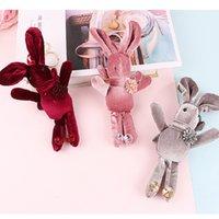 anneau de lapin rouge achat en gros de-Nouveau tissu dessin animé en peluche mignon lapin rouge rose bleu gris noir unisexe poupée porte-clés sac pendentif
