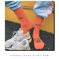 tubos de senhoras quentes venda por atacado-2019 quente cor sólida letra maré marca tubo feminino moda algodão pilha meias moda senhoras longas meias
