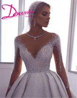 luxus kristall lange zug brautkleider großhandel-2019 Luxus Prinzessin Ballkleid Kristalle Brautkleider Arabische Illusion mit langen Ärmeln Brautkleid Sweep Zug Brautkleider billigsten