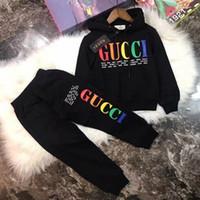 giyim kızı uzun kollu hoodie toptan satış-2019 Yeni tasarımcı Bebek Sonbahar Giysileri Set Çocuklar marka Erkek Kız uzun Kollu Hoodie Üst + Pantolon 2 Adet Takım Elbise Moda Eşofman Kıyafetleri coco