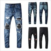 pantalones de jeans de marca al por mayor-Pantalones hombre del diseñador de la nueva manera hombres de la marca Negro jeans ajustados rasgado hombre del diseñador Jeans Denim Motociclista pantalones vaqueros para hombre